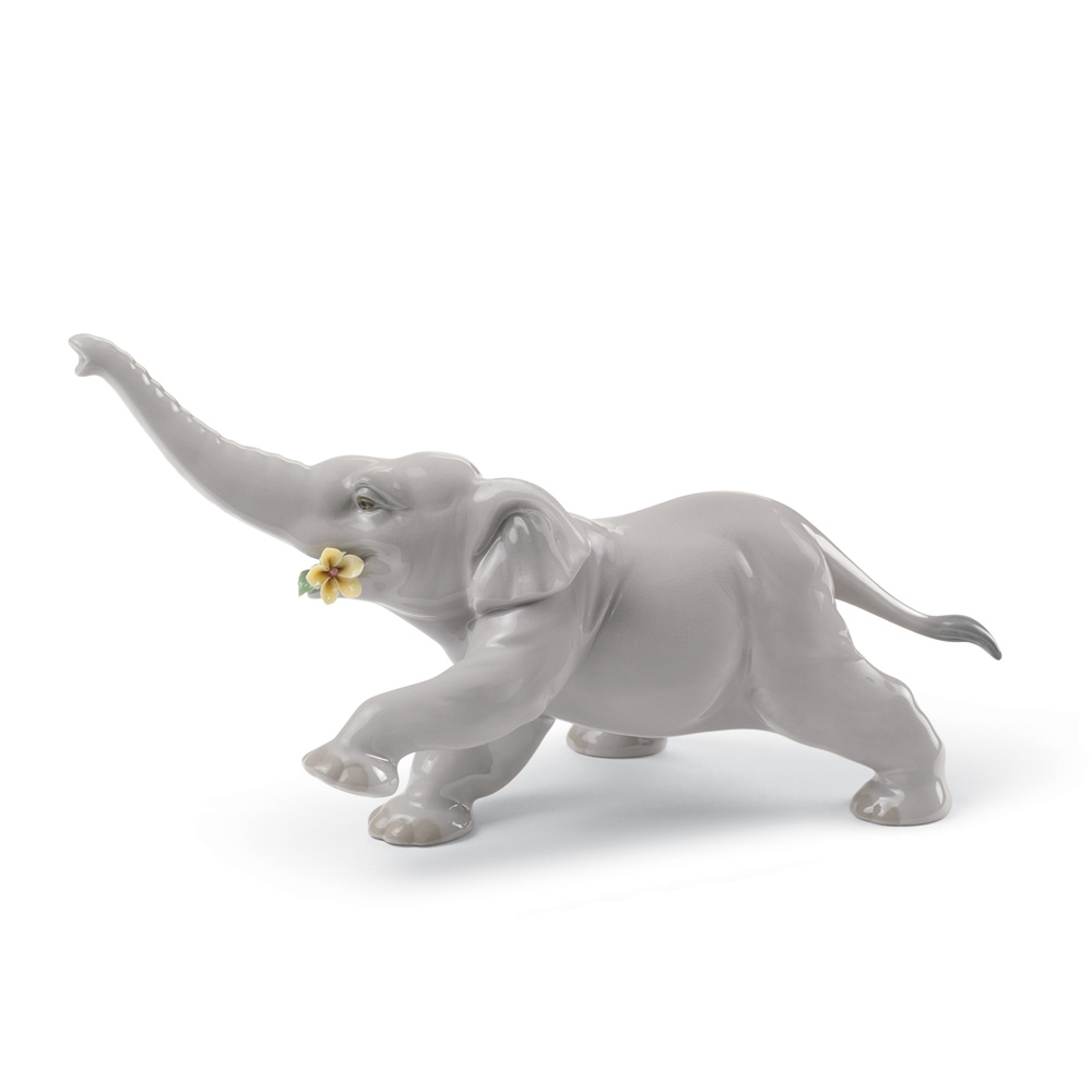 Baby Elephant With Yellow Flower 01008492 - Lladro Figurine