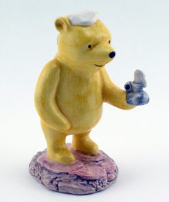 Pooh Lights The Candle WP11 - Royal Doultoun Storybook Figurine